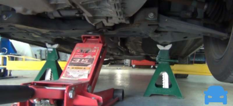 How to use a floor jack to lift a car